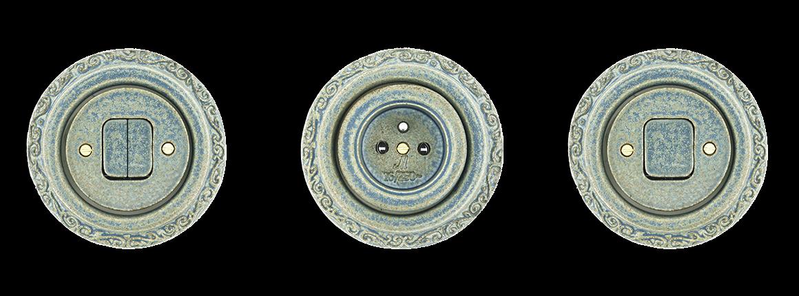 Zásuvky a vypínače keramické s patinou? Ani za 100 let? V Mulieru do 30 dnů. Mulier Ornament modrá patina.