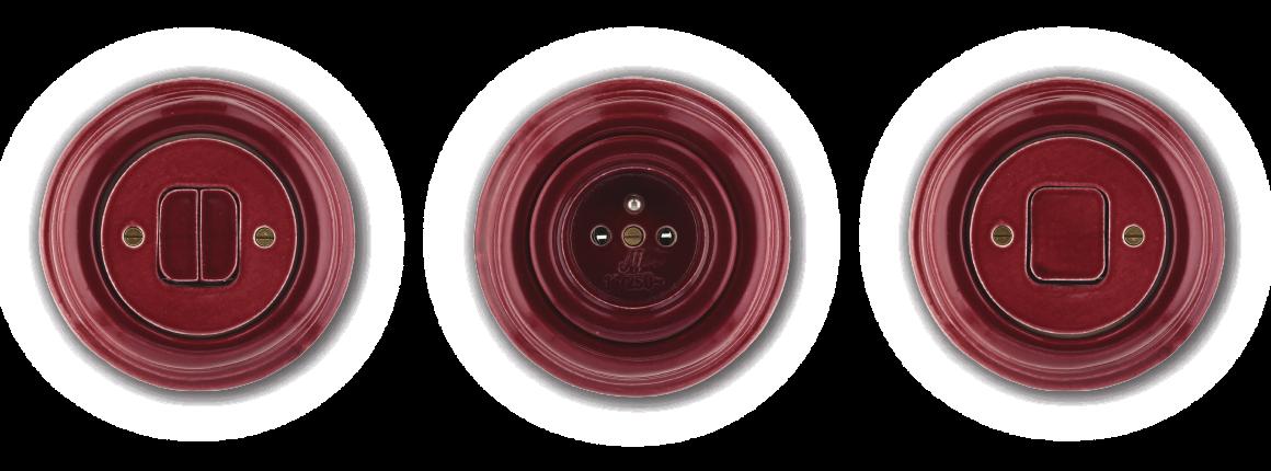 Červený kulatý dvojitý vypínač, zásuvka a vypínač z keramiky Mulier Klasik.