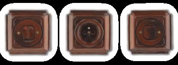 Hnědo černé vypínače a zásuvky Mulier Jindřich. Hranaté retro zásuvky.
