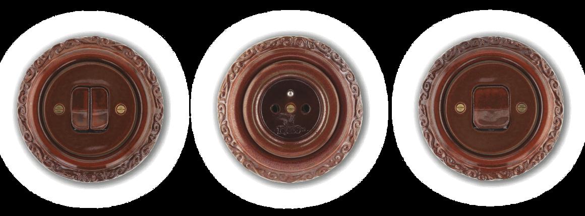 Mulier Ornament hnědá mahagon. Keramické vypínače a zásuvky kulaté zdobené po obvodu ozdobnou rytinou.