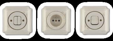 Unikátní vypínače a zásuvky Mulier Jindřich bílá blob jsou keramické a hranaté. Mají na sobě fleky.