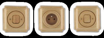 Retro vypínače a zásuvky s glazurou, která vypadá jako korek. Hranaté vyrobené z porcelánu.